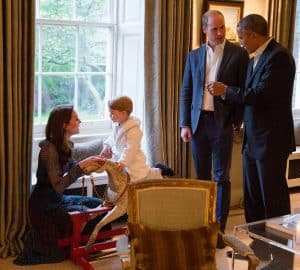 Prince George rides a Wilson Rocking Horse